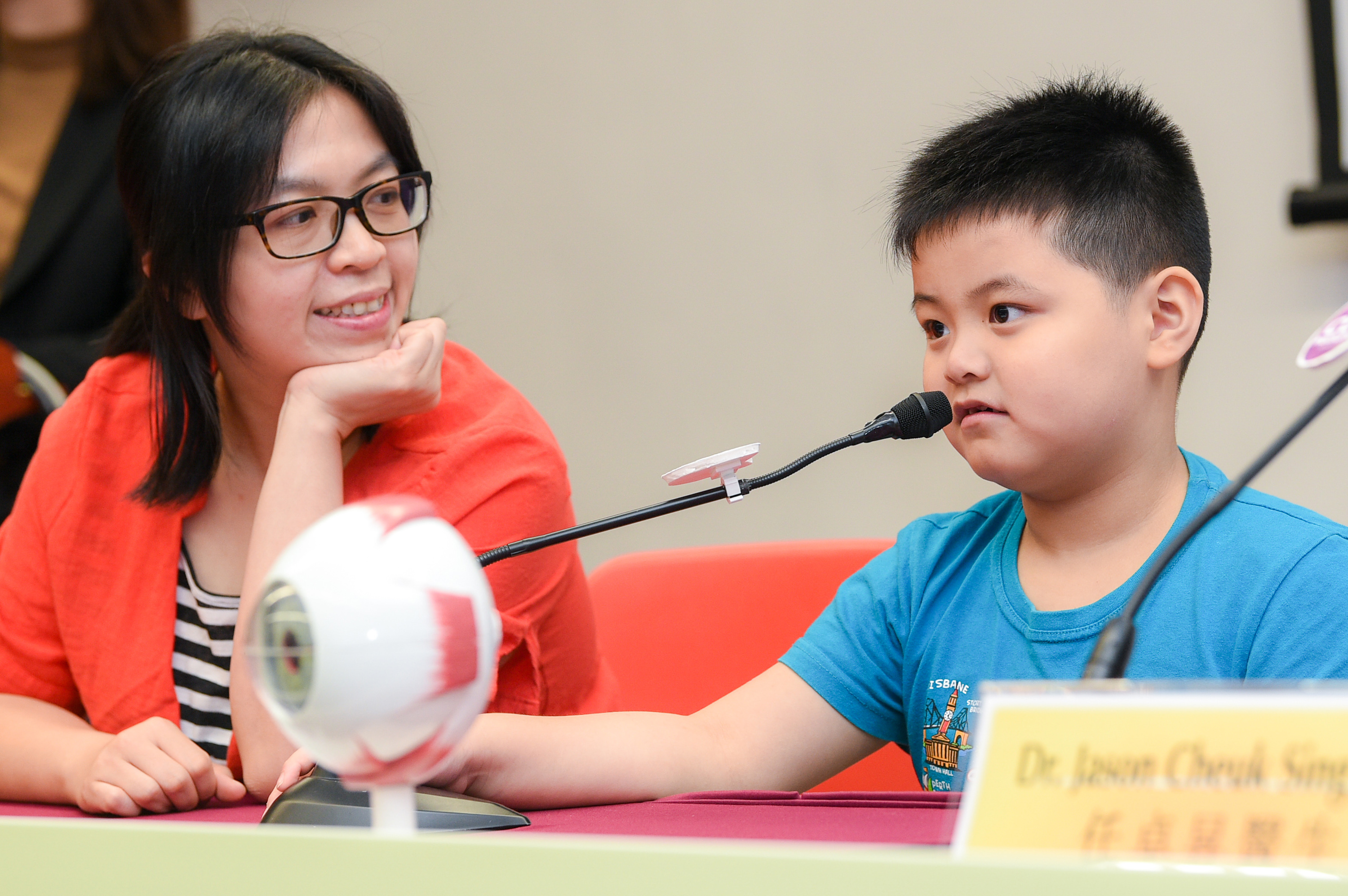 Gerrick (right) spends three to four hours watching TV or using smartphones every day. His mother Mrs. Tsang says in order to help his son prevent from myopia progression, she got him to join the LAMP study and will limit the time he spend on electronic devices in the future.
