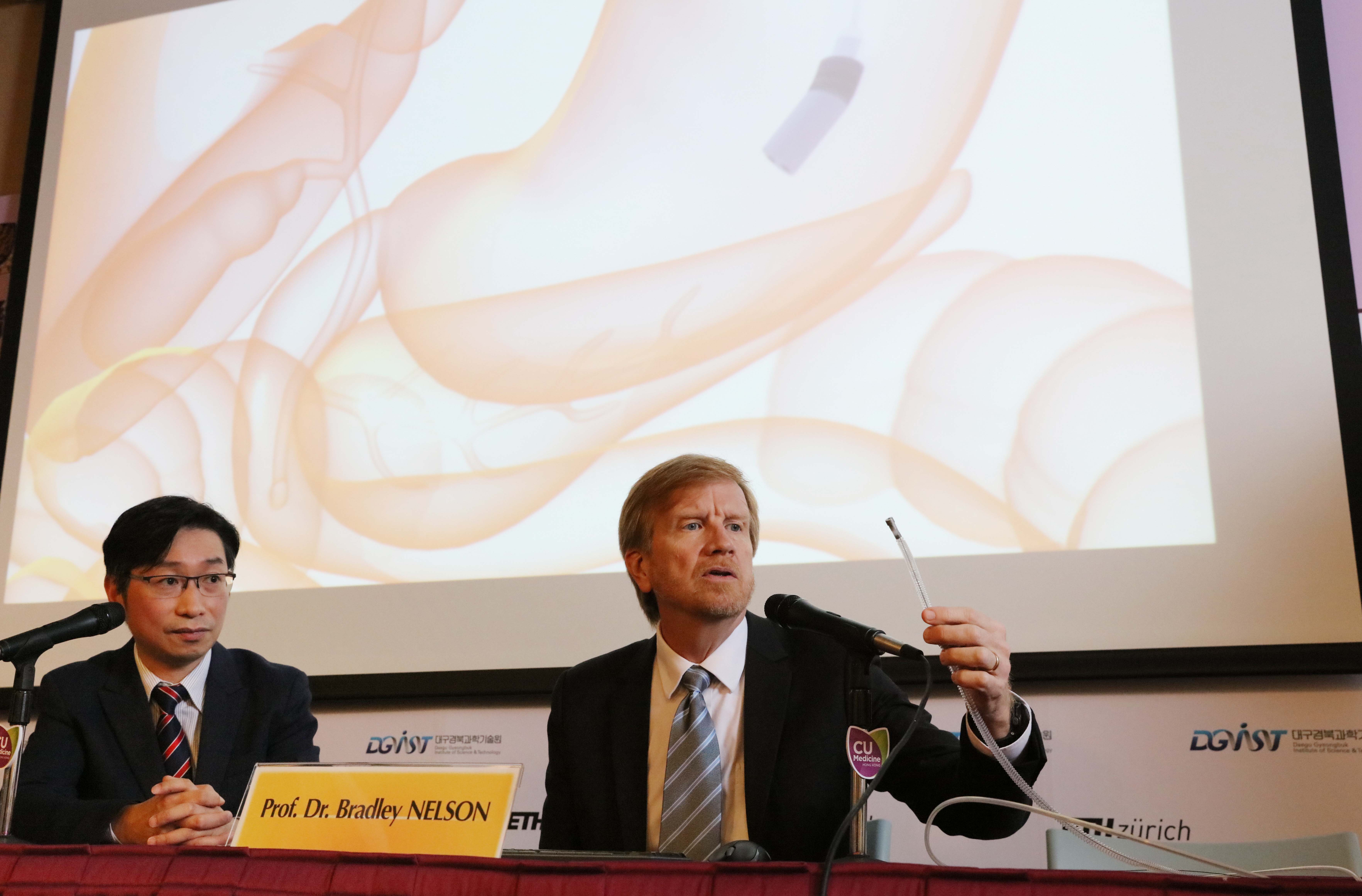 Prof. Dr. Bradley NELSON (right) displays animation of an innovative magnetic guided endoscope for small intestine check-up.