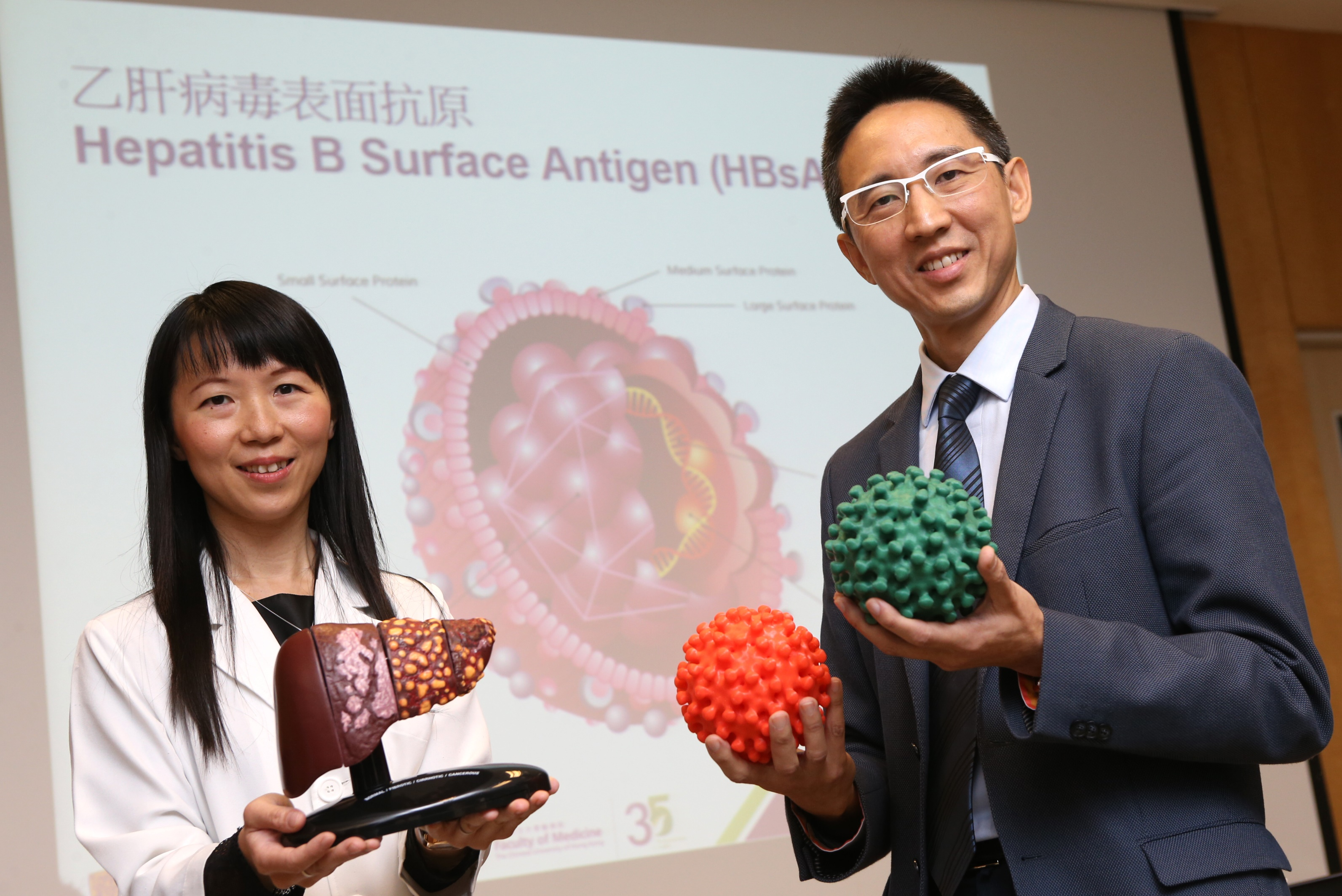 Researchers from the Faculty of Medicine of The Chinese University of Hong Kong (CUHK) find that patients with seroclearance of hepatitis B surface antigen (HBsAg), which means recovery of hepatitis B, are still at risk of developing liver cancer. Study results show that male patients who achieved recovery after the age of 50 have a higher risk. Featured are (right) Professor Henry CHAN, Director of the Center for Liver Health, Faculty of Medicine at CUHK, and Professor Grace WONG, Division of Gastroenterology and Hepatology, Department of Medicine and Therapeutics, Faculty of Medicine at CUHK.