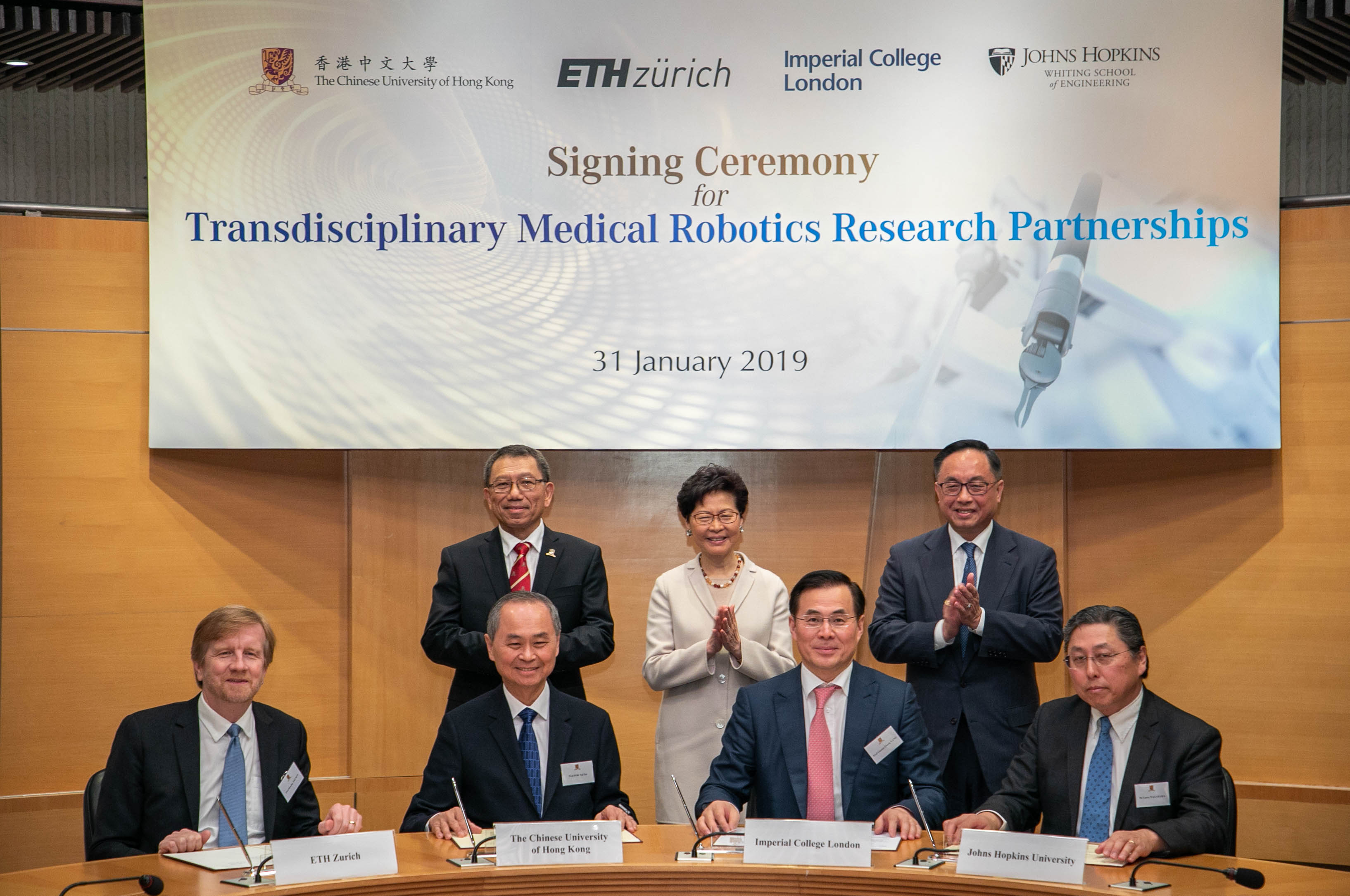 The Chinese University of Hong Kong (CUHK) established partnerships with ETH Zurich, Imperial College London and Johns Hopkins University to deepen ties on transdisciplinary medical robotics research. The event was witnessed by The Hon Mrs. Carrie LAM CHENG Yuet-ngor (back row center), The Chief Executive of the Hong Kong Special Administrative Region (HKSAR); Professor Rocky S. TUAN (back row left), Vice-Chancellor and President of CUHK; and Mr. Nicholas W. YANG (back row right), Secretary for Innovation and Technology of the HKSAR Government.