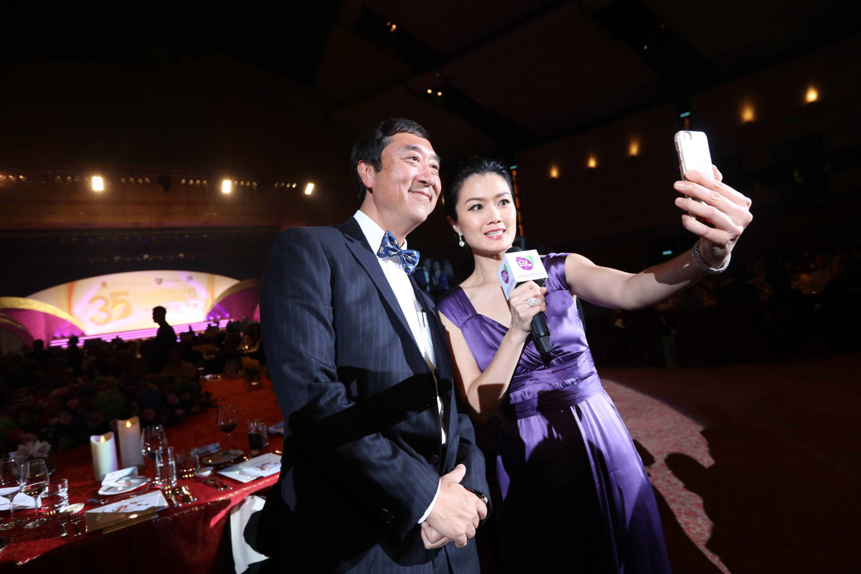 Vice-Chancellor Prof. Joseph SUNG and host of dinner Ms. Akina FONG take a mobile selfie.